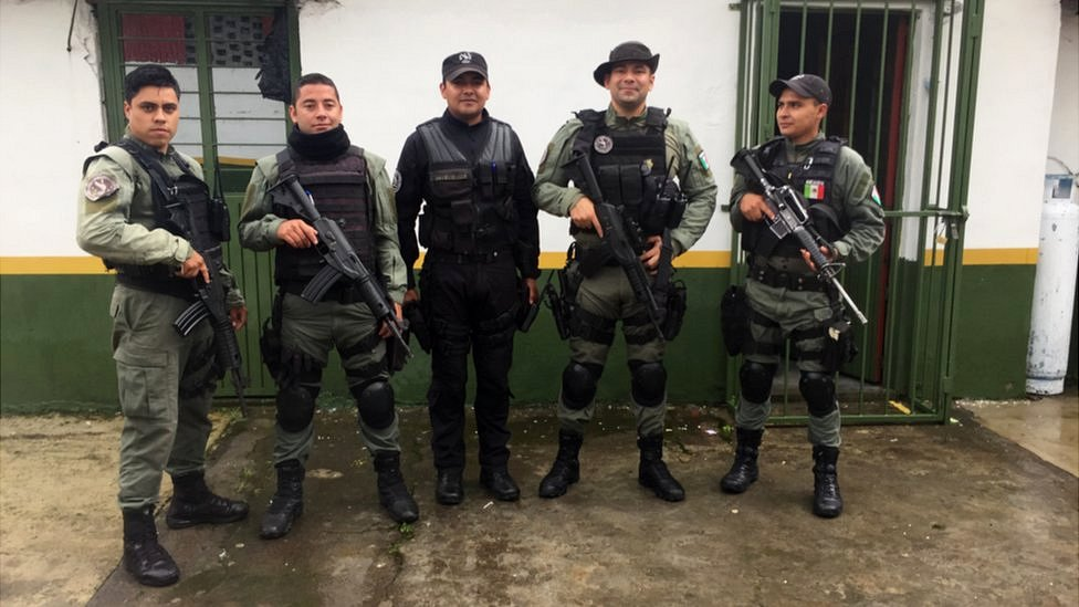 Members of CUSEPT pose for a photo with their weapons