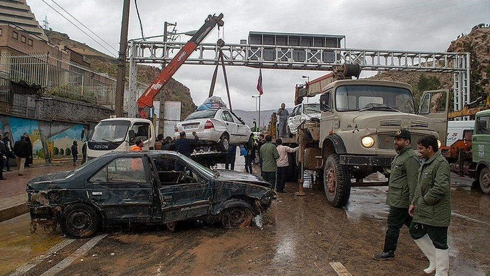 Damaged vehicles are seen after a flash flooding In Shiraz, Iran, March 25, 2019