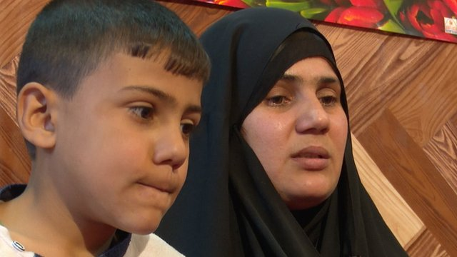 Om Hussein and her son