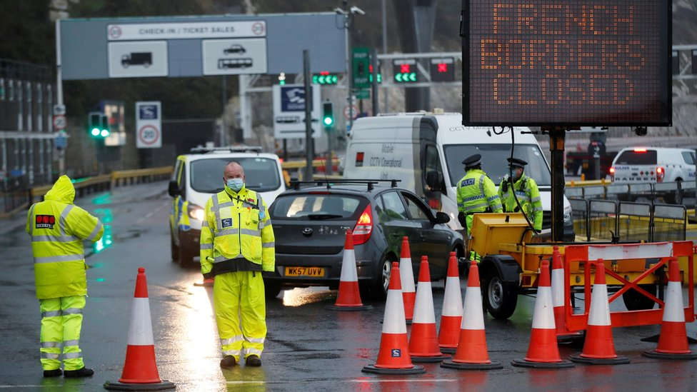 Security officers stand guard at an entrance of the Port of Dover