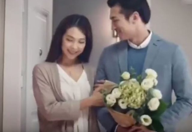 A Chinese woman poses with her boyfriend in a screengrab from the scrapped Chinese Ikea advert