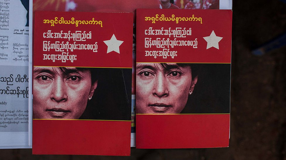 Booklets bearing Aung San Suu Kyi's face in Myanmar after her party swept to victory in November 2015's election