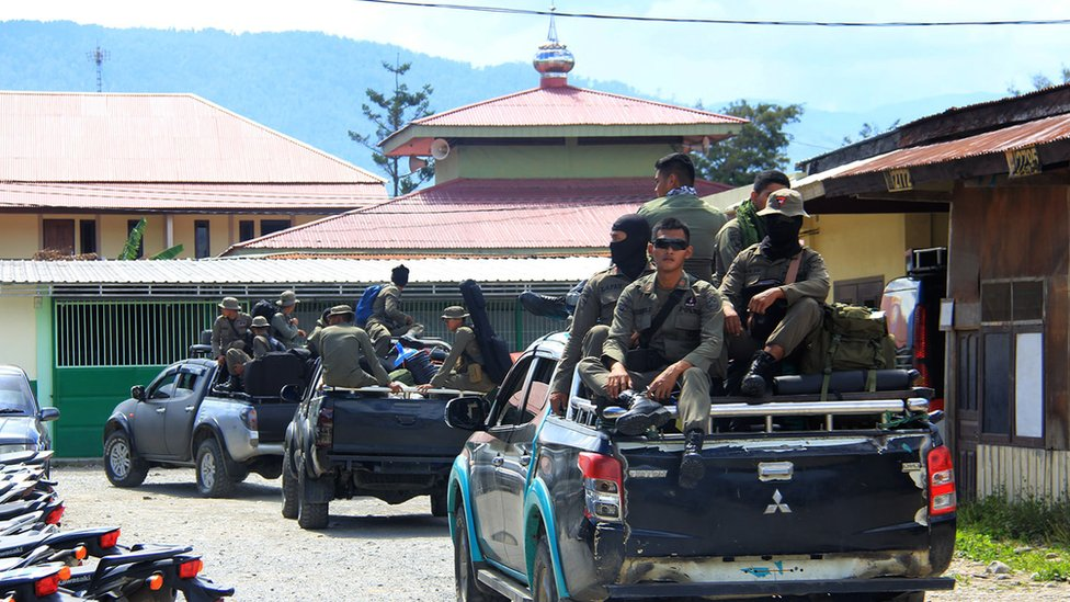 Indonesian Mobile Brigade Police head to Nduga, where 31 construction workers are believed to have been shot dead, from Wamena on December 4, 2018
