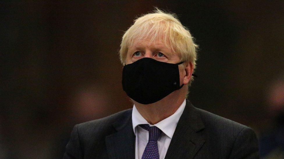 Boris Johnson wearing a face mask