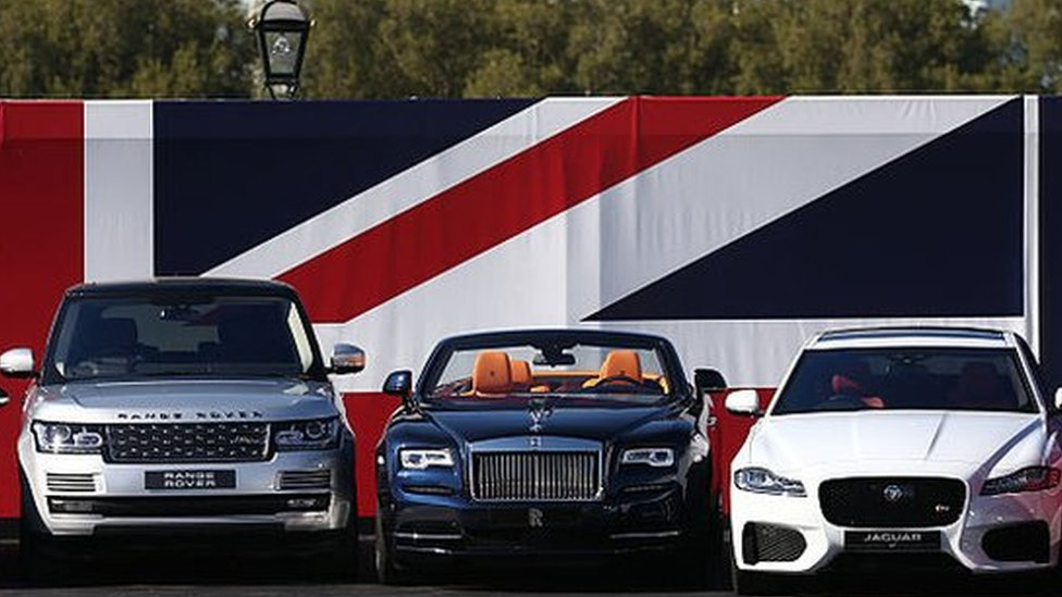 Cars in front of union jack flag
