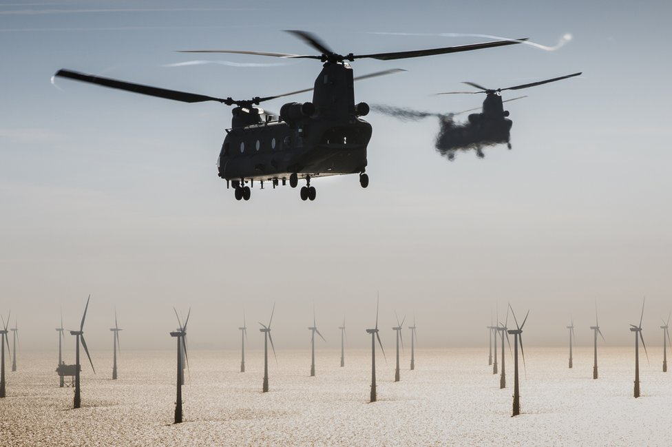 Two RAF Chinooks head out over North Sea wind farms