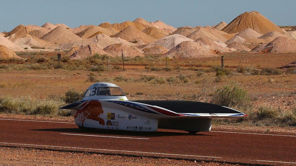 Nuna8 of Nuon Solar Team Netherlands arrive into Coober Pedy as they race on day four in the Challenger Class of the 2015 World Solar Challenge on October 21, 2015 in Coober Pedy, Australia. Teams from across the globe are competing in the 2015 World Solar Challenge - a 3000 km solar-powered vehicle race between Darwin and Adelaide.