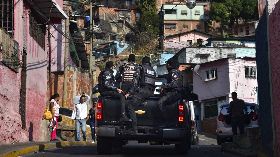 Members of Venezuela's Special Action Forces (FAES) carry out a security operation in Caracas