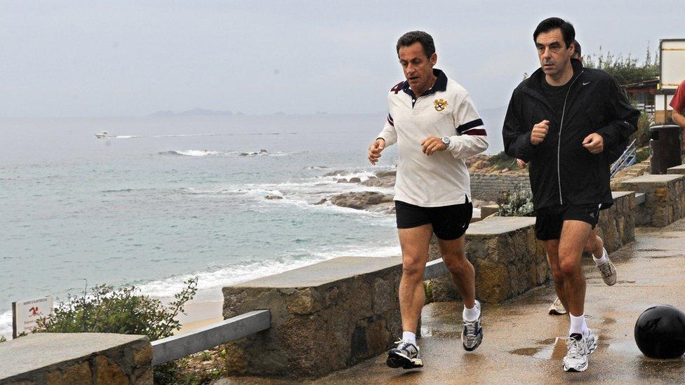 Then-French President Nicolas Sarkozy (L) and Francois Fillon jogging