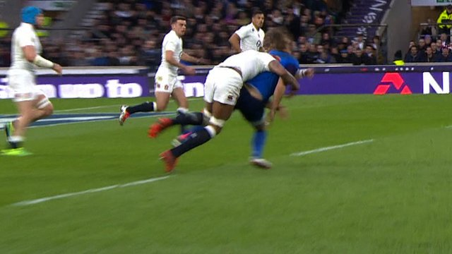 Courtney Lawes tackles Jules Plisson