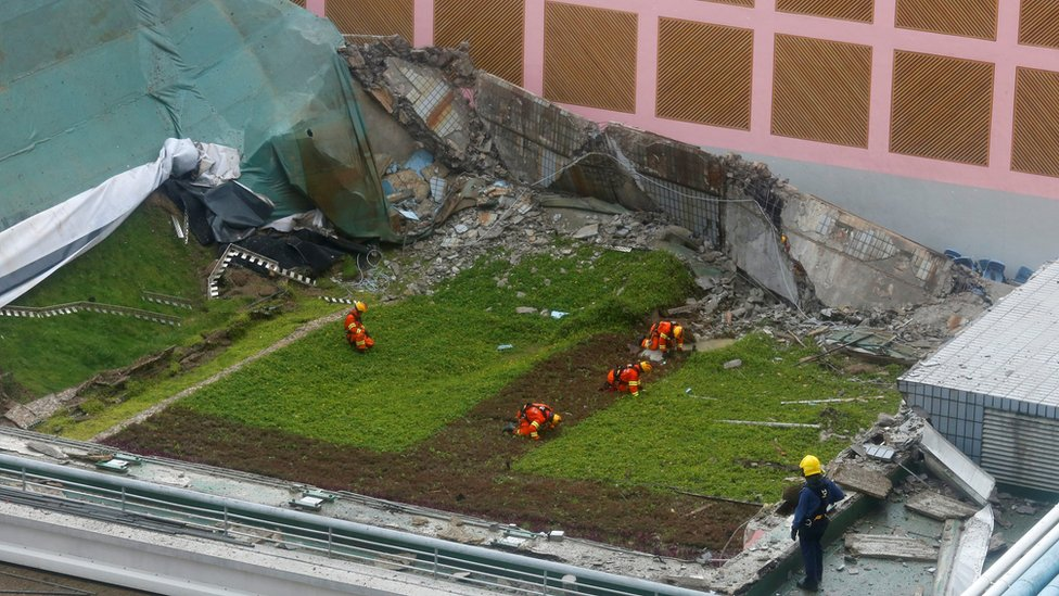 Rescuers search for casualties after the 900-square-metre grass-covered roof of an indoor hall at a City University sports centre collapsed in Hong Kong