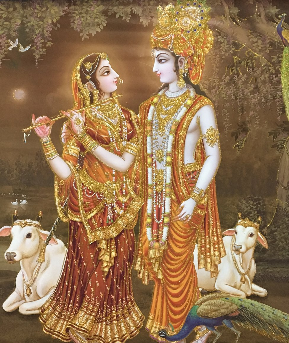 A calendar image of Hindu god Krishna with his consort Radha