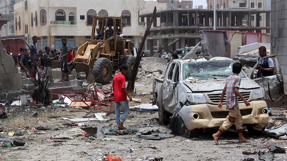 Yemenis inspect the site of a suicide car bombing claimed by the Islamic State group on 29 August 2016 at an army recruitment centre in the southern Yemeni city of Aden