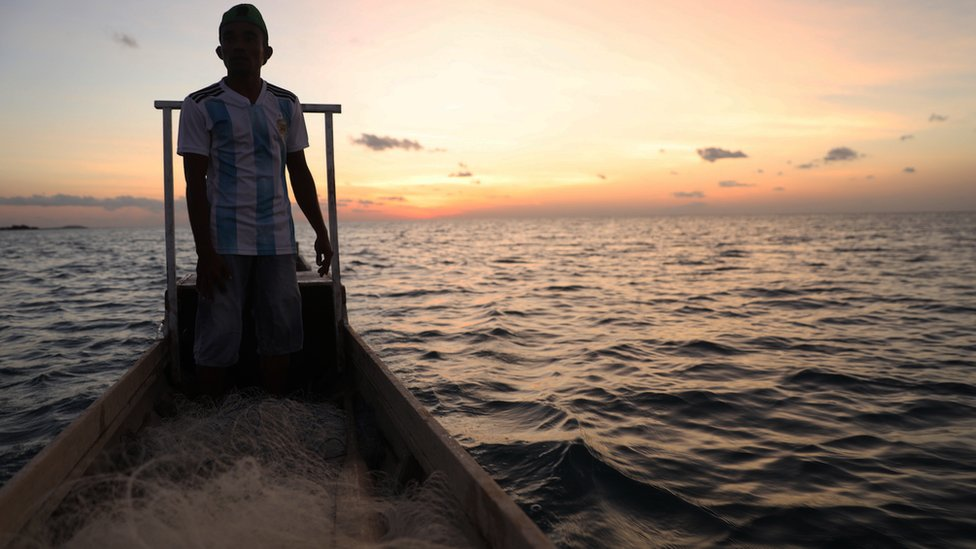 Abdul on fishing boat off the coast of Rote in Indonesia