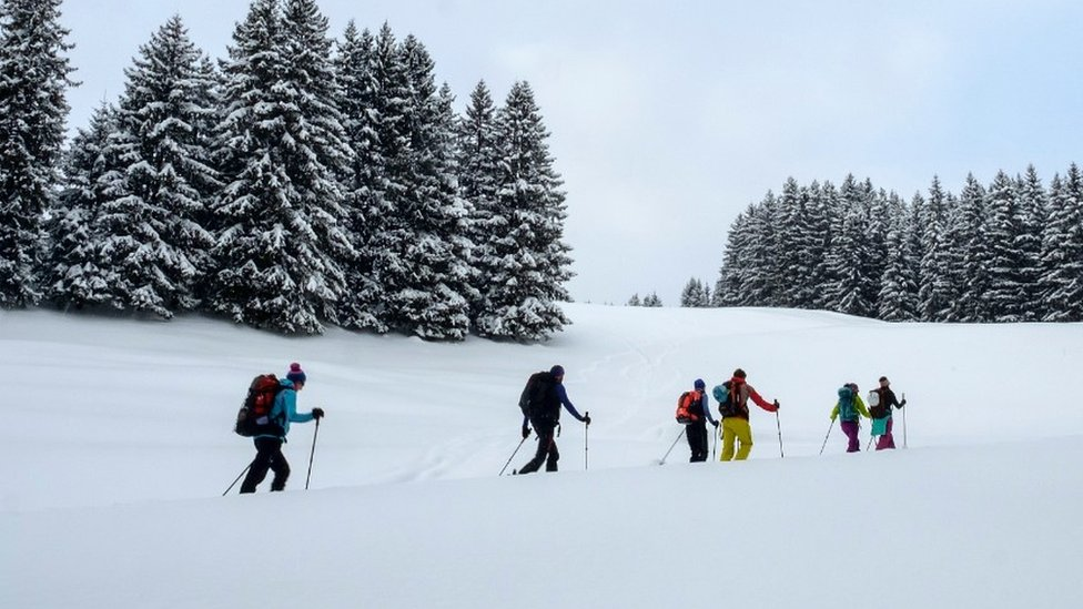 People on a ski touring trek in the Austrian Alps