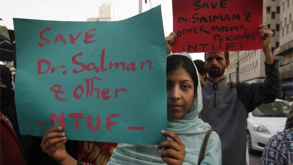 Activists of Pakistan civil society rally to condemn the missing human rights activist Salman Haider, in Karachi, Pakistan, Monday, Jan. 9, 2017.