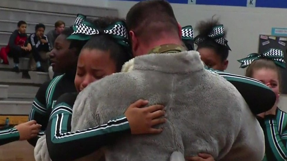 US Air Force dad surprises daughters as dolphin mascot