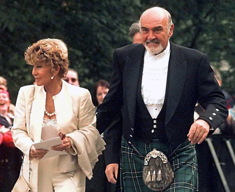 Sean Connery with wife Micheline Roquebrune arriving at the opening of the first Scottish Parliament in Edinburgh in 1999
