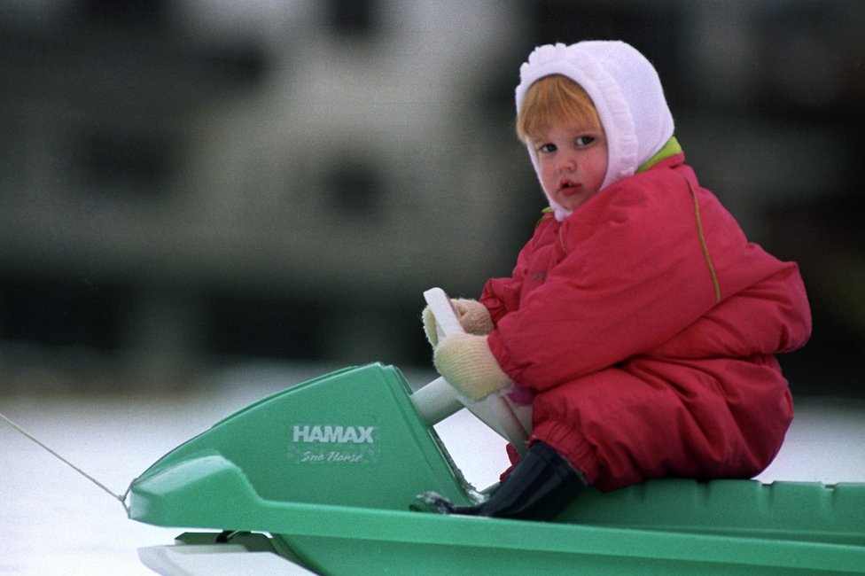 Princess Beatrice takes to the controls of a sledge on the slopes near the Swiss village of Klosters