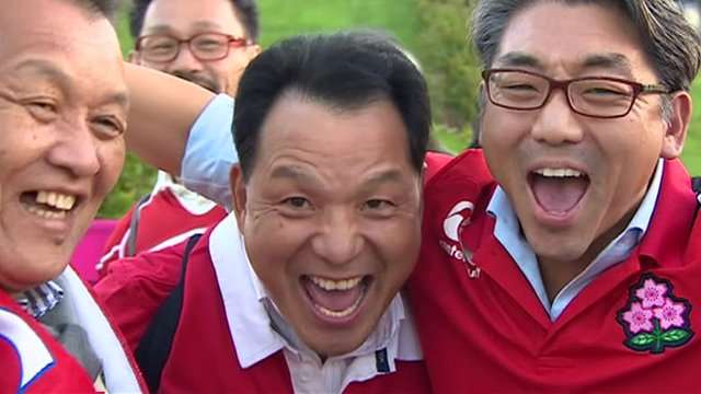 Japanese rugby fans celebrate their team's surprise win in the Rugby World Cup