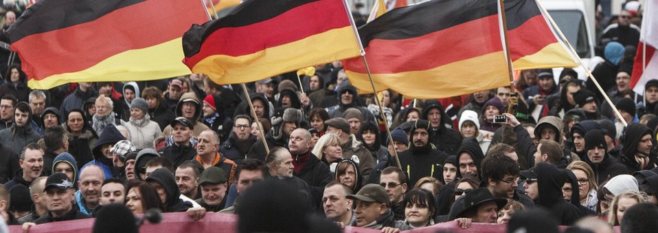 Right-wing activists gather to march in the city centre and protest against German Chancellor Angela Merkel on March 12, 2016