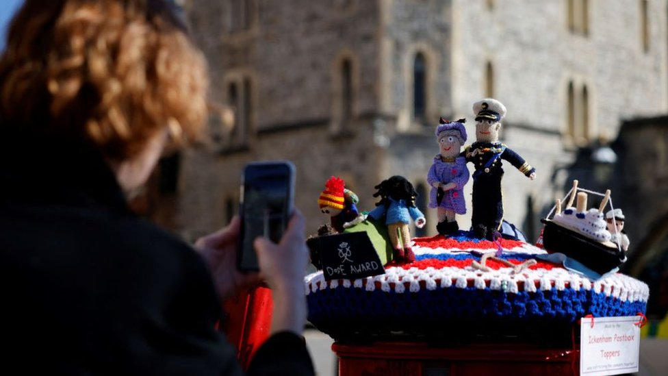 Knitted post box toppers featuring Queen Elizabeth II and Prince Philip, Duke of Edinburgh are pictured in Windsor, west of London, on April 17, 2021