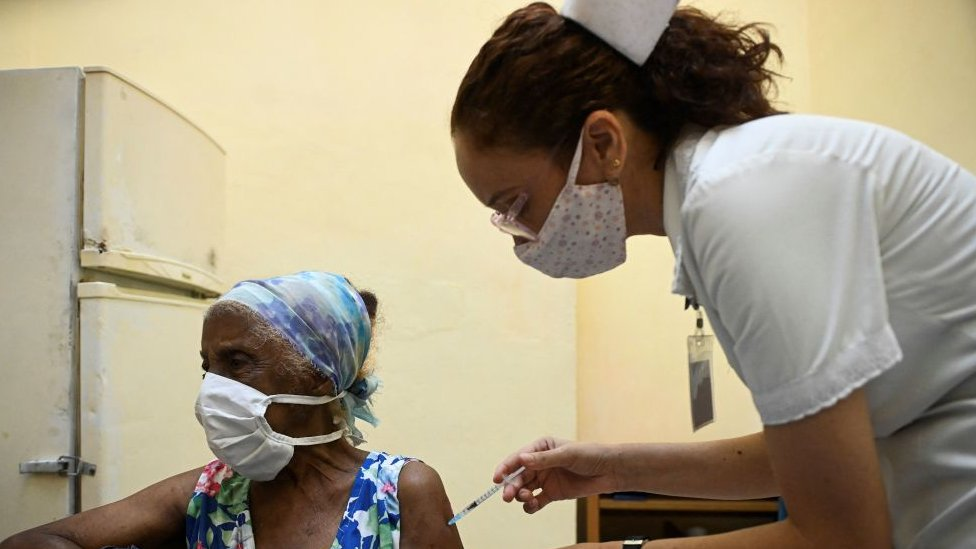 A nurse vaccinates an elderly woman against COVID-19 with Cuban vaccine Abdala in Havana, on August 2, 2021