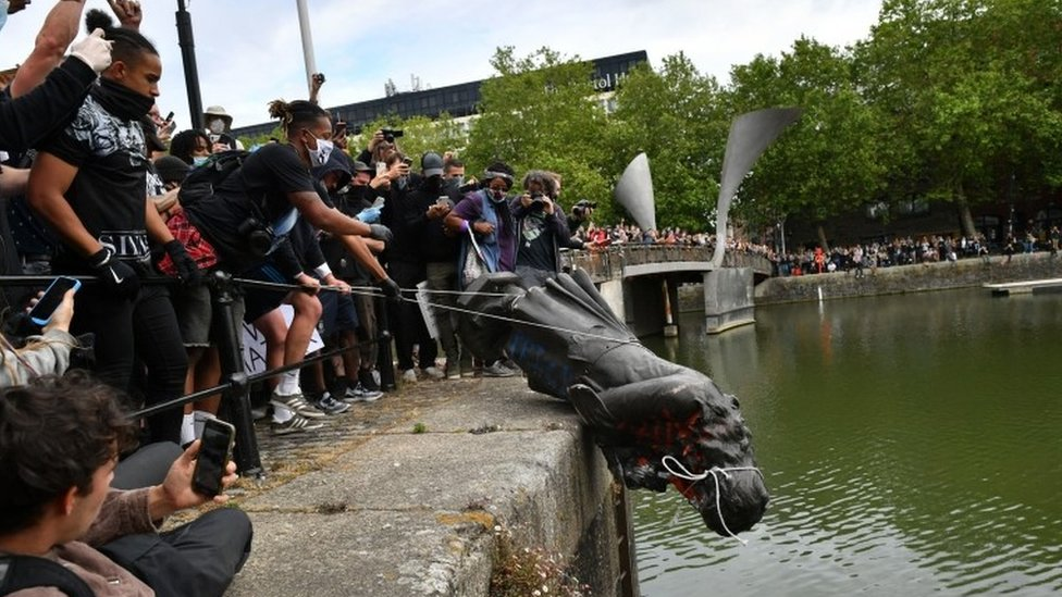 Colston statue lowered into Bristol harbour