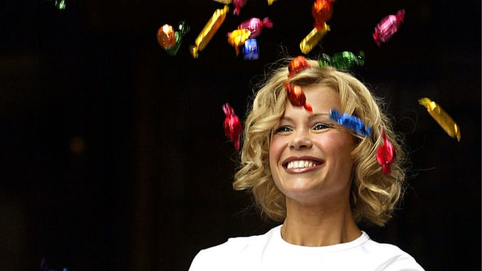 Melinda Messenger throws chocolates in the air