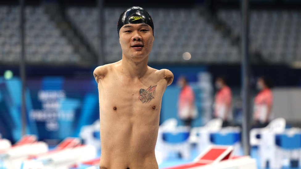 Zheng Tao of Team China reacts after competing in the Men's 50m Freestyle