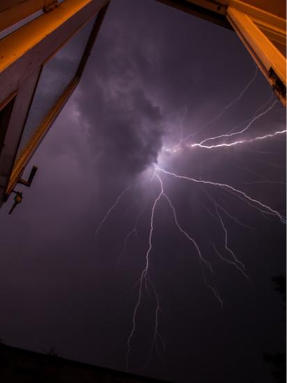 Lightning as seen through a window