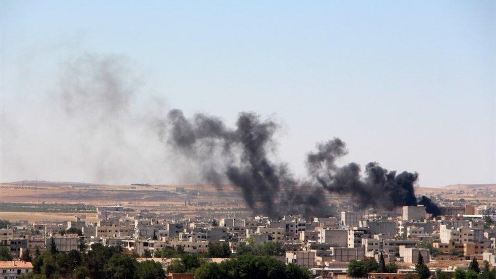 Smoke billow from the Syrian town of Kobane, 25 June