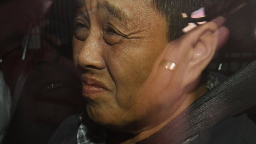 My Ut Trinh after being arrested by police
