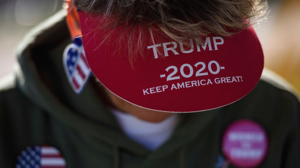 Trump supporter wearing Trump 2020 peaked cap