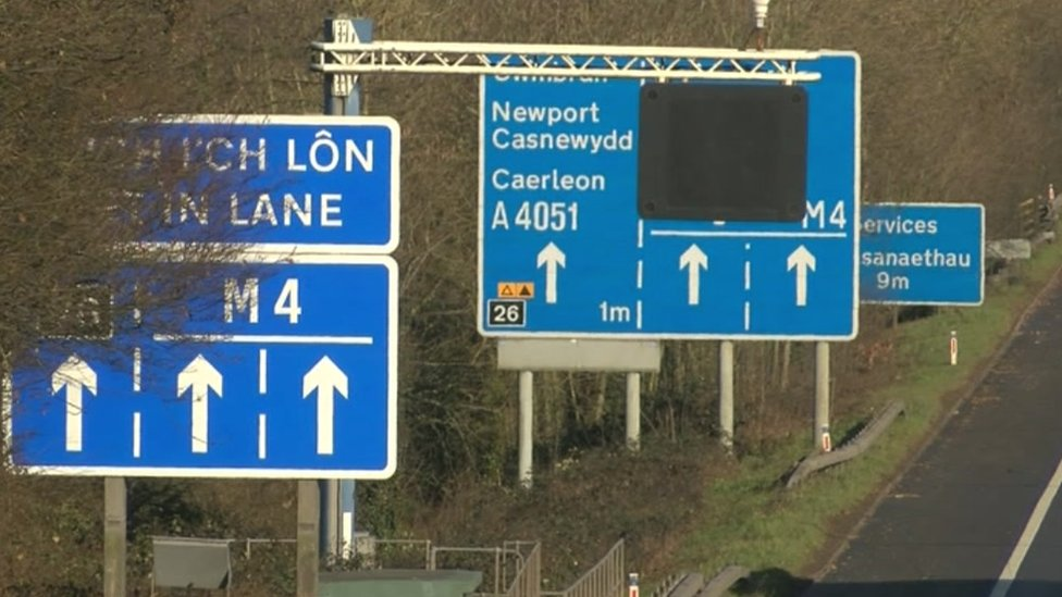 Signs alongside M4