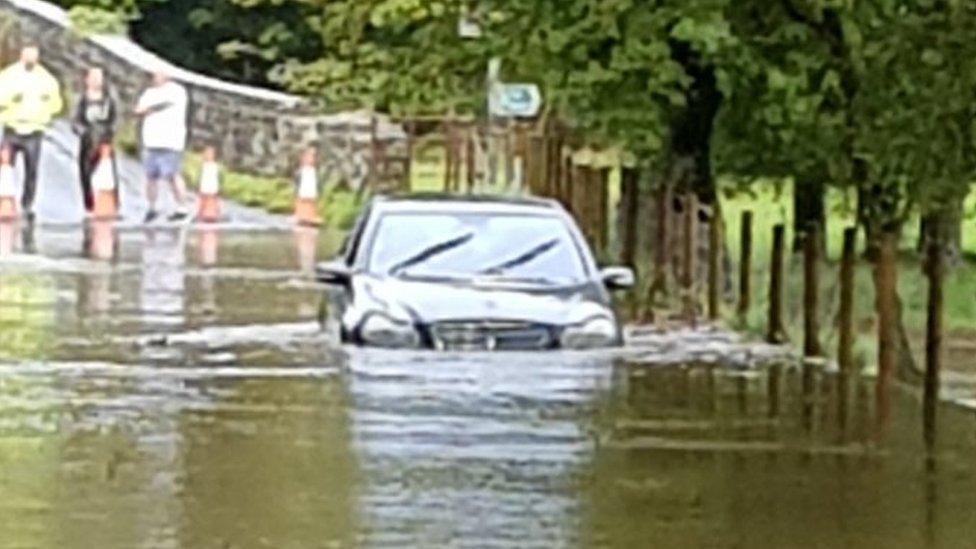 Car stuck at Dipping Bridge near Merthyr Mawr