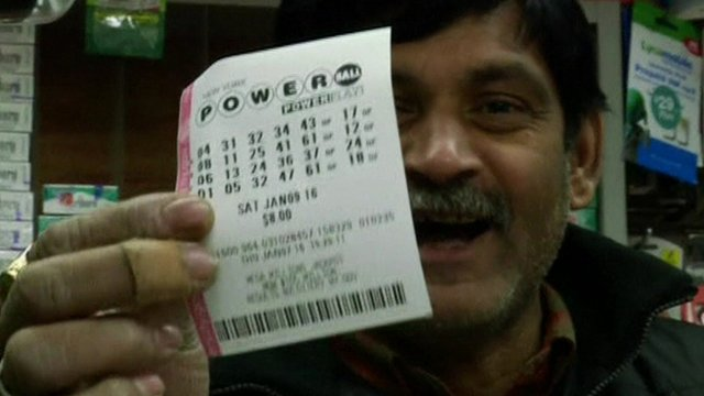 Man holding a lottery ticket
