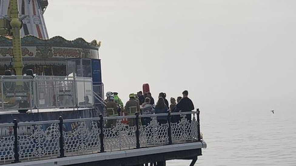 Emergency services at the scene at the end of the pier