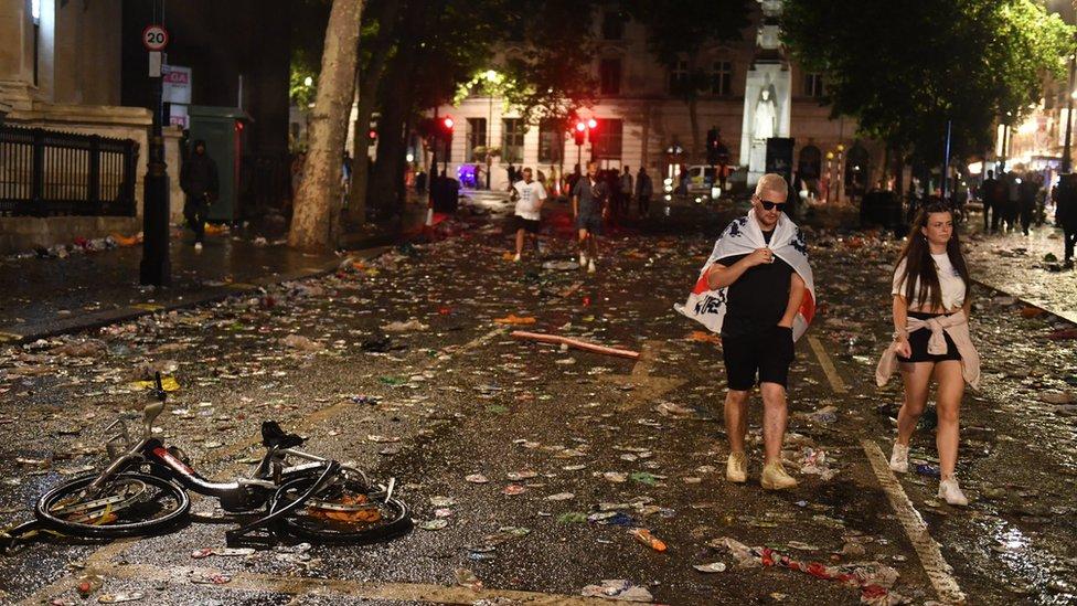 Dejected fans leave the central London fan zone