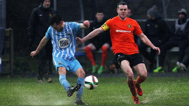 Action from Warrenpoint Town against Carrick Rangers