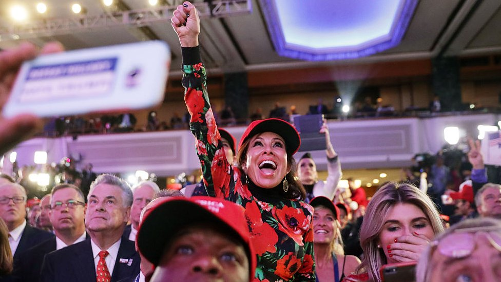 upporters of Republican presidential nominee Donald Trump cheer during the election night event at the New York Hilton Midtown on November 8, 2016 in New York City.