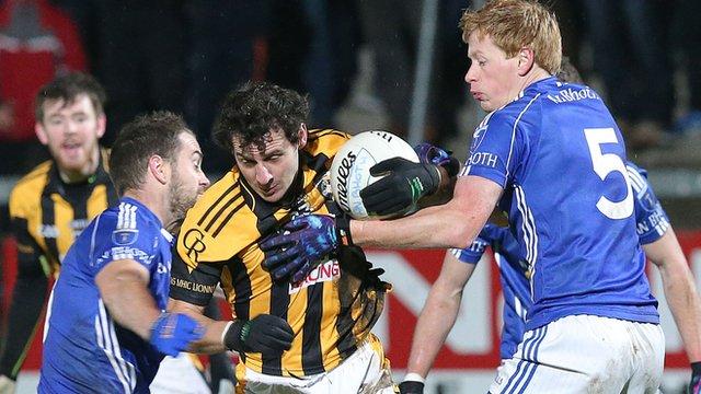 Scotstown pair Mark Duffy and Emmet Duffy tackle Crossmaglen forward Jamie Clarke