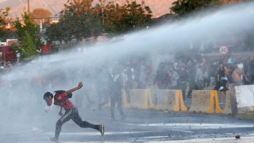 Police fire water cannon at protesters