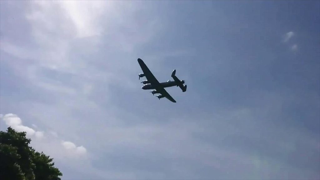 Lancaster bomber flies over Eyebrook Reservoir in Leicestershire