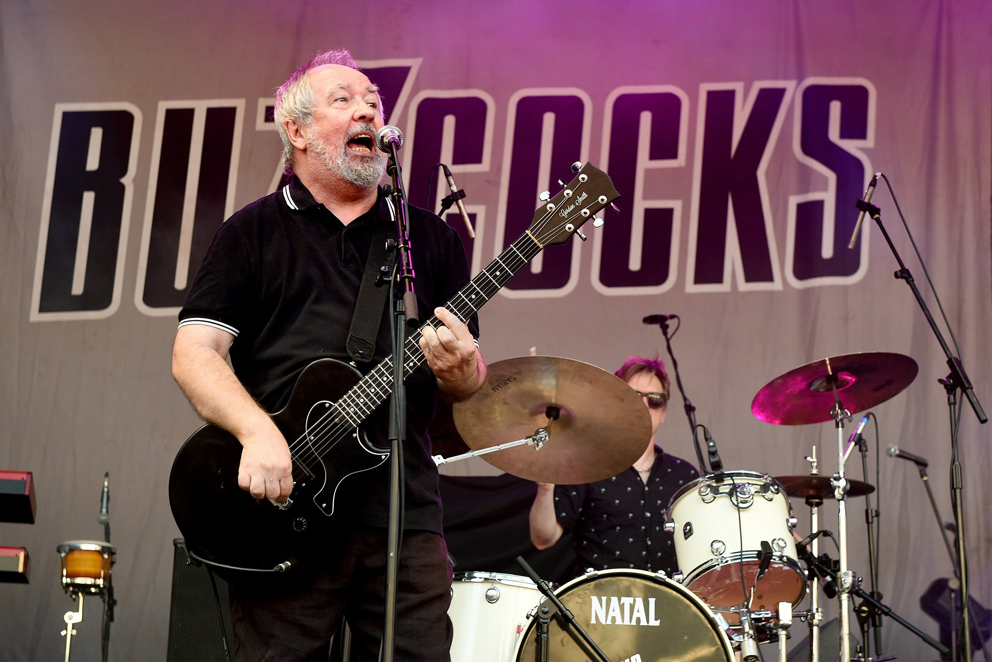 Pete Shelley of Buzzcocks performs during Sounds of the City at Castlefield Bowl on July 6, 2018 in Manchester