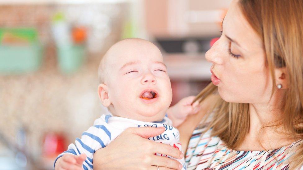 Mum singing to baby