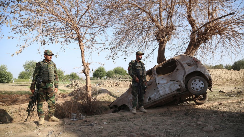 Afghan security forces inspect the site of bomb attack which targeted a National Directorate of Security (NDS) office in Jalalabad, Afghanistan, 03 October 2020.