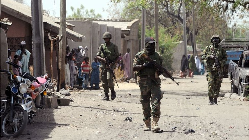 Nigerian troops patrolling in the streets of the remote northeast town of Baga, Borno State on 30 April, 2013