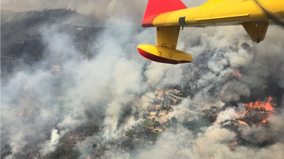 Aerial view of a forest fire is seen from the cabin of a Spanish 43 Grupo fire fighting plane near Pedrógão Grande, Portugal, 19 June 2017
