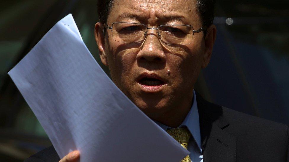 North Korean Ambassador to Malaysia, Kang Chol, waves paper as he speaks outside the embassy in Kuala Lumpur, Malaysia (February 20, 2017)